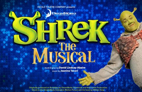 Shrek appears open armed from the side of the image with Shrek The Musical next to him.
