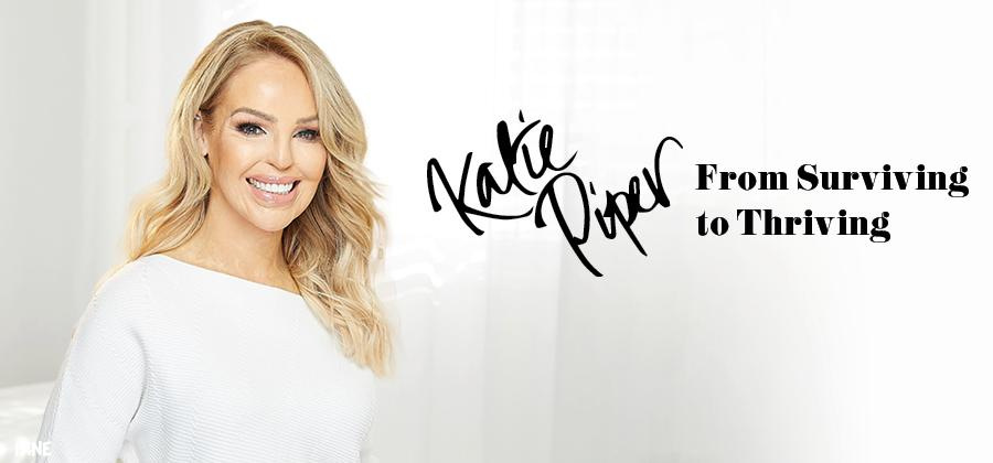 Katie Piper in white jumper against white background beaming at the camera