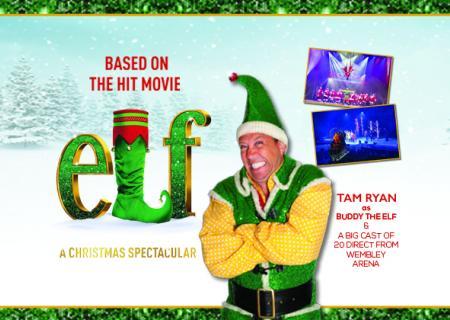 Buddy the Elf in front of Elf logo